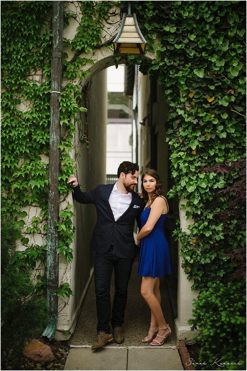 Vine archway, couple poses beneath